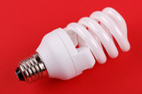 energy saving bulb on red
