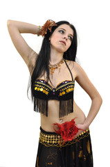 Young beautiful bellydancer in black costume with flowers