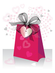 Gift bag with bow and heart shaped tag