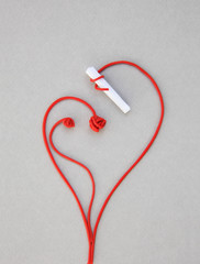 A stalk rolled up around a closed paper drawing red heart