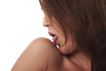 Girl with pierced tongue licks on his shoulder