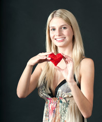 Beautiful young blond girl with heart