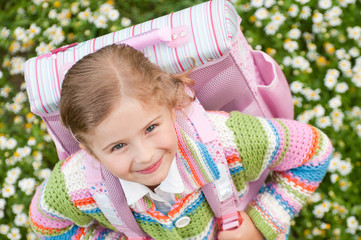 Happy little schoolgirl - outdoor portrait