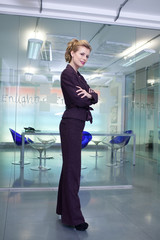 Confident businesswoman standing with crossed arms