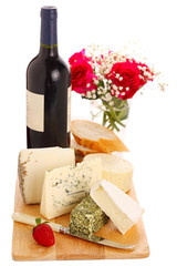 Different cheese with wine and roses isolated on white backgroun