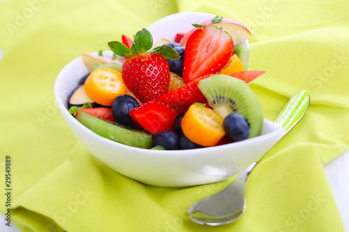 Fruity summer salad in white bowl