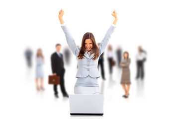 business woman with her hands raised while working on