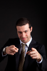 Picture of a young businessman pointing you