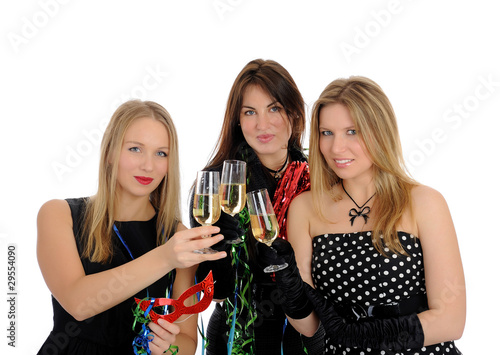 Group of three beautiful woman with glasses of champagne celebra