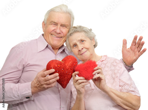 happy old couple with red hearts