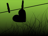 Paper heart drying on the rope with clothes peg - green