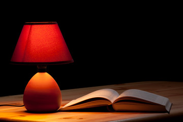 Lamp illuminating a book
