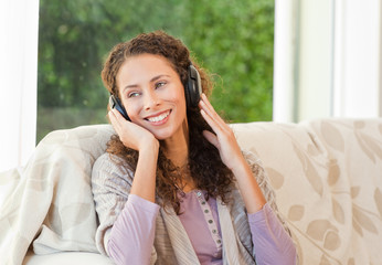 Radiant woman listening to music