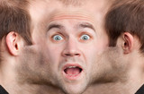 Panoramic face of frightened man