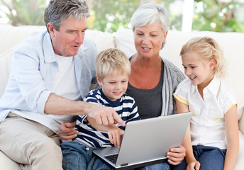 Adorable family looking at their laptop