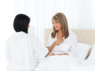 Mature woman talking with her nurse