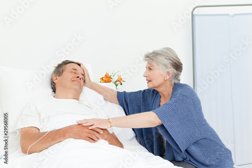 Mature woman taking care of her husband