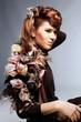 Face of beautiful caucasian brunet woman in brown elegant dress