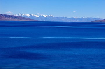 Landscape of blue lake and snow covered mountains
