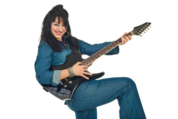 Laughing woman with guitar