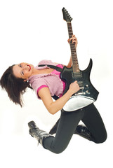 Smiling young woman playing rock guitar