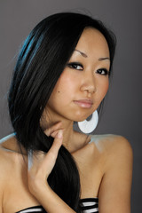 Beautiful asian woman hold her hair