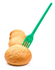 Row of buns and fork
