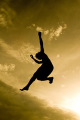 freestyle gymnast silhouette in golden sky