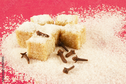 Blocks of sugar and spiciness on a red background