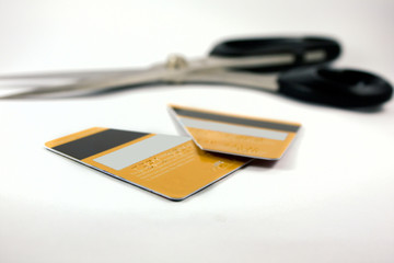 the pieces of credit card and scissors