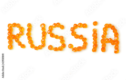 "Word ""Russia"" written by red caviar on a white background"