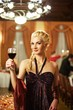 Attractive blond woman with a glass of red wine