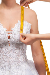 Measuring the distance from shoulder to breast