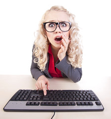 Shocked girl at a computer