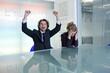 Cheering businessman next to depressed businesswoman
