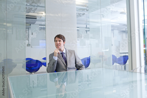 Businessman in conference room thinking