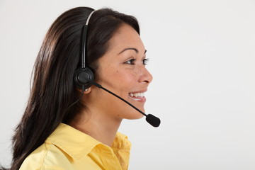 Headshot happy receptionist speaking on telephone