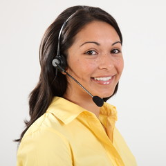 Beautiful smiling receptionist on the telephone