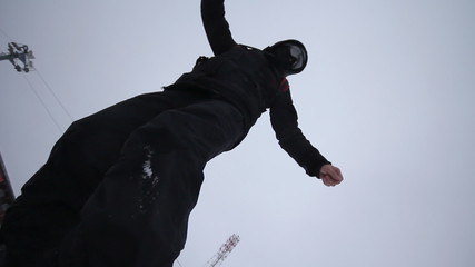 Snowboarder coming down on a snowboard