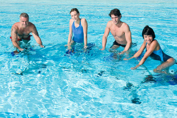 Happy people exercising with water aqua bike