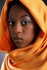 Beautiful young black girl wearing headress