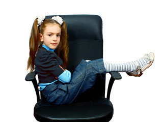 a girl sitting in chair