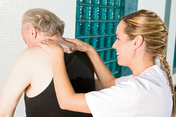 Nurse performing back's massage