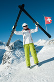 Happy skier in winter resort poster