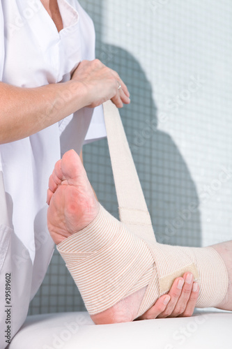 Applying a bandage to a leg