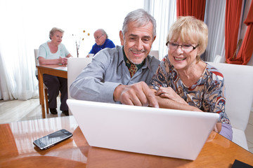 Happy people in the retirement house