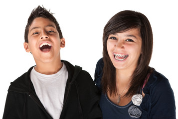 Two Smiling Siblings