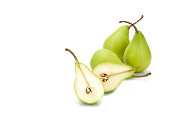 three  whole green pears and one halved