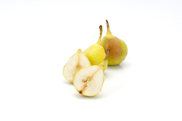 two yellow pears and one halved