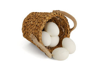 Eggs spilled from interwoven basket